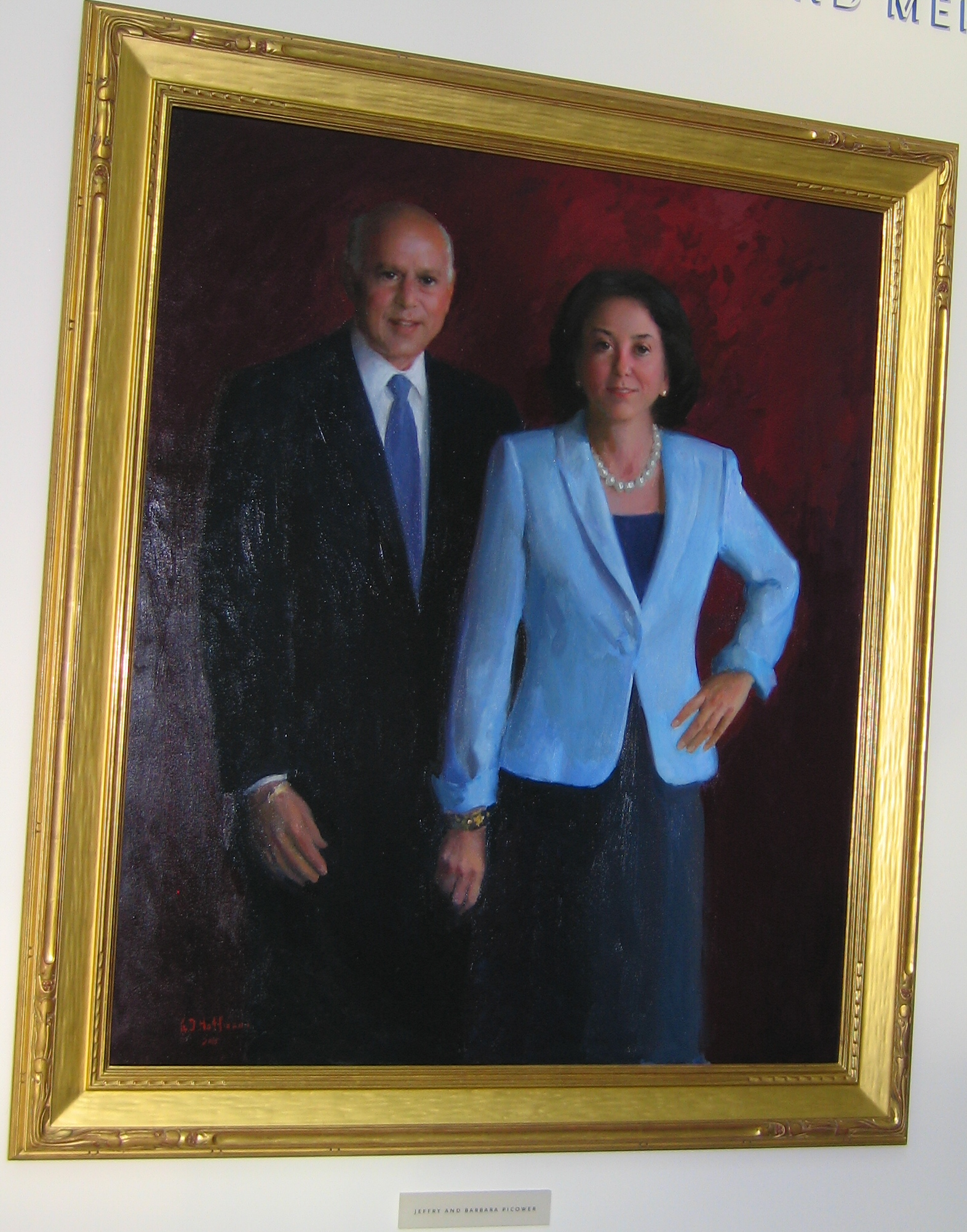 portrait of Barbara and Jeffry Picower hangs in MIT building lobby